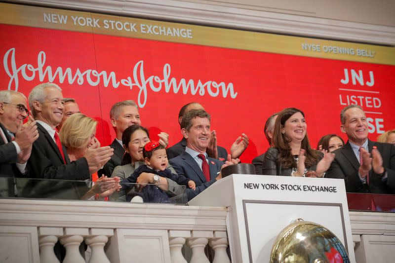 FILE PHOTO: Alex Gorsky, Chairman and CEO of Johnson & Johnson, rings the opening bell to celebrate the 75th anniversary of his company's listing at the NYSE in New York