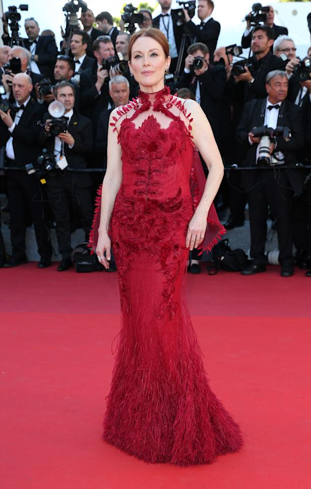 <p>Julianne was a red carpet hit in an ornate scarlet look by Givenchy.<br /><i>[Photo: Getty]</i> </p>