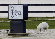 FILE - In this May 1, 2020, file photo, a sign sits in front of the Tyson Foods plant in Waterloo, Iowa. Hundreds of meatpacking workers have been vaccinated against the coronavirus but the union that represents them says several hundred thousand more have not, despite the risks they continue to face at work. (AP Photo/Charlie Neibergall, File)