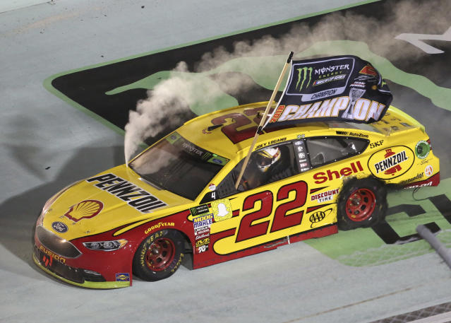 Joey Logano (22) does a burnout after winning the NASCAR Cup Series championship auto race at Homestead-Miami Speedway, Sunday, Nov. 18, 2018, in Homestead, Fla. (AP Photo/David Graham)