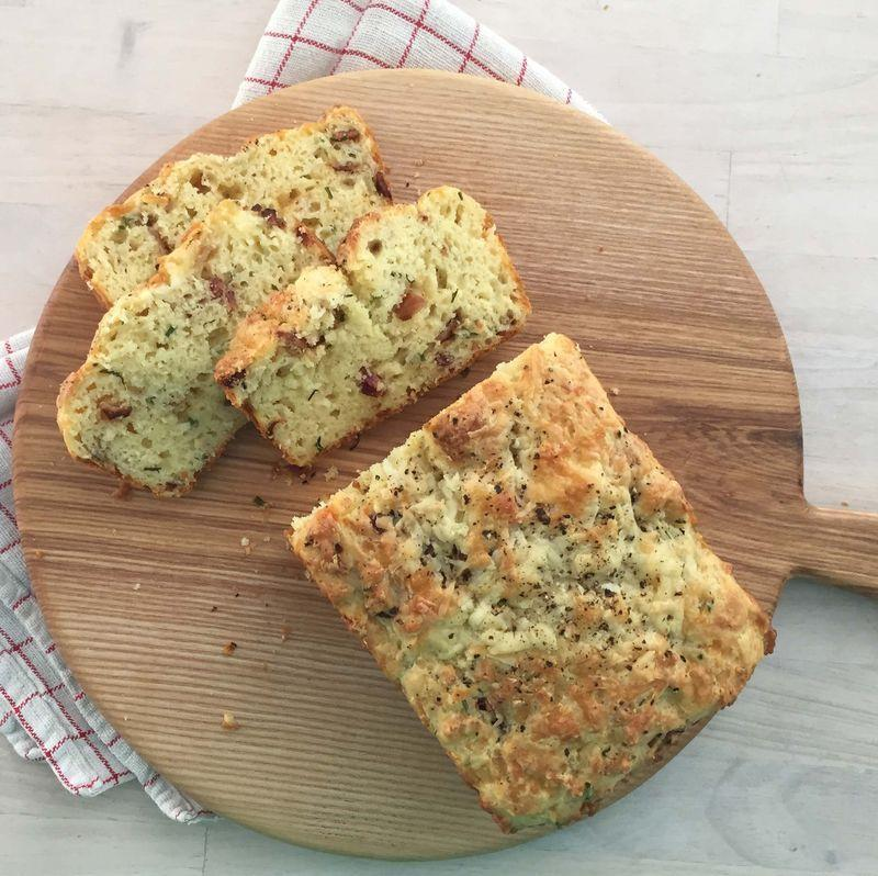 """<p>This easy plan-ahead loaf can be baked up a day or two in advance, and then each slice can simply be warmed in the toaster or oven.</p><p><strong><a href=""""https://www.countryliving.com/food-drinks/a32213633/cheddar-bacon-and-chive-quick-bread/"""" rel=""""nofollow noopener"""" target=""""_blank"""" data-ylk=""""slk:Get the recipe"""" class=""""link rapid-noclick-resp"""">Get the recipe</a>.</strong></p><p><strong><a class=""""link rapid-noclick-resp"""" href=""""https://www.amazon.com/USA-Pan-1140LF-Bakeware-Aluminized/dp/B0029JQEIC/?tag=syn-yahoo-20&ascsubtag=%5Bartid%7C10050.g.2144%5Bsrc%7Cyahoo-us"""" rel=""""nofollow noopener"""" target=""""_blank"""" data-ylk=""""slk:SHOP LOAF PANS"""">SHOP LOAF PANS</a><br></strong></p>"""