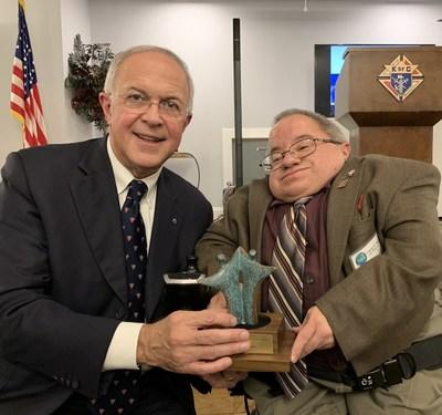 Michael Adamus, a board member of the National Catholic Partnership on Disability, presents an award by the NCPD to Knights of Columbus Supreme Knight Carl Anderson in recognition of the extensive work done by the Knights of Columbus on behalf of people with disabilities. Adamus is also the grand knight of K of C Holy Cross Council 12235 in Orlando, FL.