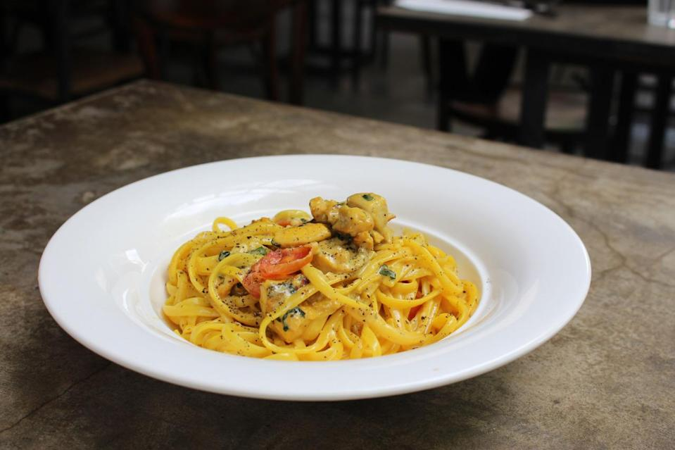 Foodies will be satisfied by the Linguine ($26) tossed in a light Saffron sauce that is topped with cherry tomatoes, basil and rosemary chicken. (Photo: Yahoo Singapore)