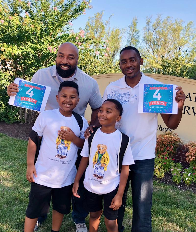 Rodney Chambers and Ron Covington with sons Charles and Carlos. (Photo courtesy of Rodney Chambers)