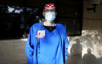 Nurse Teri Wheat poses for a photo in Fort Worth, Texas, Thursday, Nov. 19, 2020. As Wheat recently made her rounds at a Texas maternity ward, she began to realize she was having a hard time understanding the new mothers who were wearing masks due to the coronavirus pandemic. Hearing specialists across the U.S. say they have seen an uptick in visits from people like Wheat, who only realized how much they relied on lip reading and facial expressions when people started wearing masks that cover the nose and mouth. (AP Photo/LM Otero)