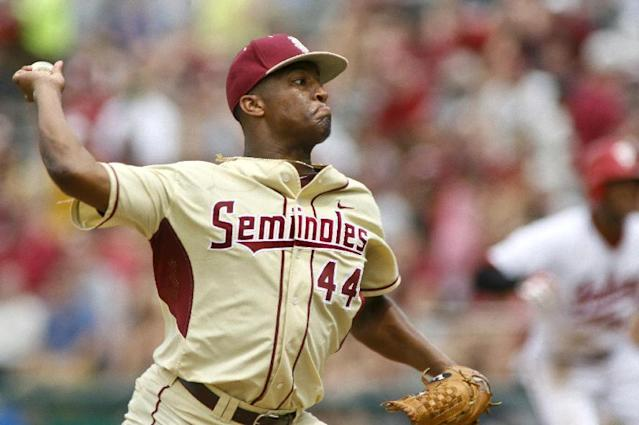 FILE - In this June 9, 2013, file photo, Florida State pitcher Jameis Winston (44) throws in the seventh inning of an NCAA college baseballtournamentsuper regionalgame against Indiana in Tallahassee, Fla. He already has a Heisman Trophy and national championship in football on his resume and is the front-runner to win the job as the team's closer on the Seminoles squad favored to win the ACC Atlantic Division and make a run for a spot in the college World Series. (AP Photo/Phil Sears, File)