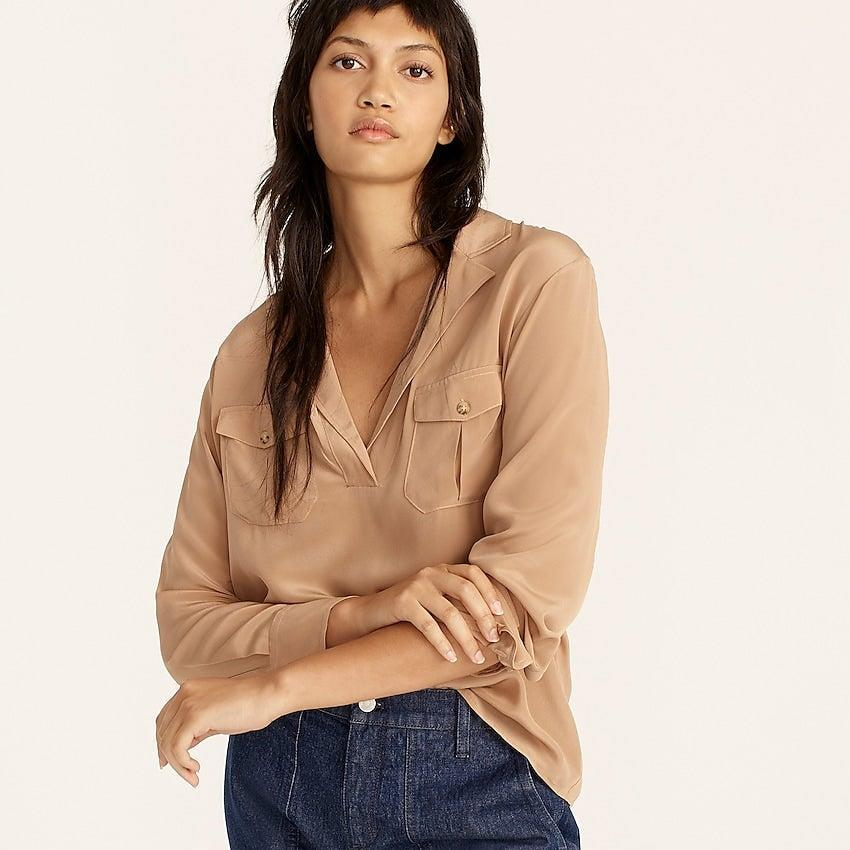 """<br><br><strong>J. Crew</strong> Silk patch pocket popover shirt, $, available at <a href=""""https://go.skimresources.com/?id=30283X879131&url=https%3A%2F%2Fwww.jcrew.com%2Fp%2Fwomens%2Fcategories%2Fclothing%2Fshirts-and-tops%2Fsilk-patch-pocket-popover-shirt%2FBB250%3Fdisplay%3Dsale%26fit%3DClassic%26isFromSale%3Dtrue%26color_name%3Dpale-mocha%26colorProductCode%3DBB250"""" rel=""""nofollow noopener"""" target=""""_blank"""" data-ylk=""""slk:J. Crew"""" class=""""link rapid-noclick-resp"""">J. Crew</a>"""