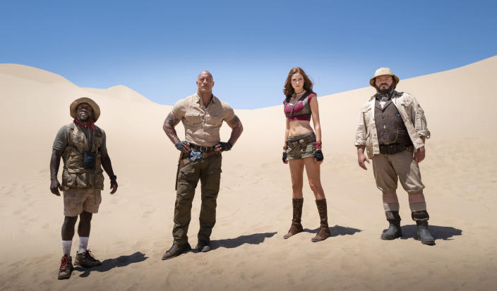 """This image released by Sony shows Kevin Hart, from left, Dwayne Johnson, Karen Gillan and Jack Black in a scene from """"Jumanji: The Next Level."""" Netflix scored a multi-year deal that will make it the new streaming home to Sony Pictures' top releases in the U.S. Beginning next year, Sony's new films will stream domestically on Netflix after their theatrical runs. That includes movies in popular franchises like """"Spider-Man,"""" """"Venom"""" and """"Jumanji."""" (Hiram Garcia/Sony via AP)"""