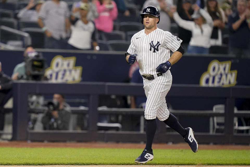 New York Yankees' Brett Gardner runs home to score after hitting a three run-home run off Cleveland Indians relief pitcher Nick Wittgren during the seventh inning of a baseball game Friday, Sept. 17, 2021, in New York. (AP Photo/John Minchillo)
