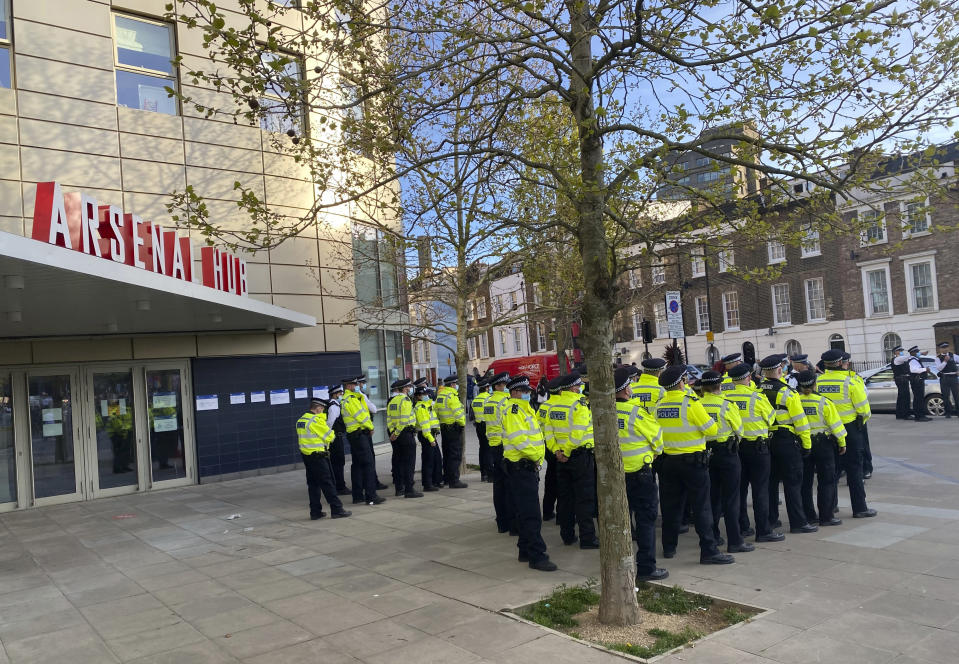 Police gather as fans protest nearby against Arsenal owner Stan Kroenke before their English Premier League soccer match against Everton, outside the Emirates Stadium in London, Friday April 23, 2021. The fans want owner Stan Kroenke to leave the club over its bid to join the failed Super League. (AP Photo / Frank Giffiths)