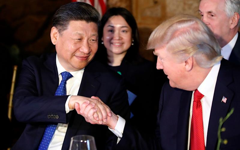 President Donald Trump, right, shakes hands with Chinese President Xi Jinping during a dinner at Mar-a-Lago, Thursday, April 6, 2017, in Palm Beach, Fla - AP