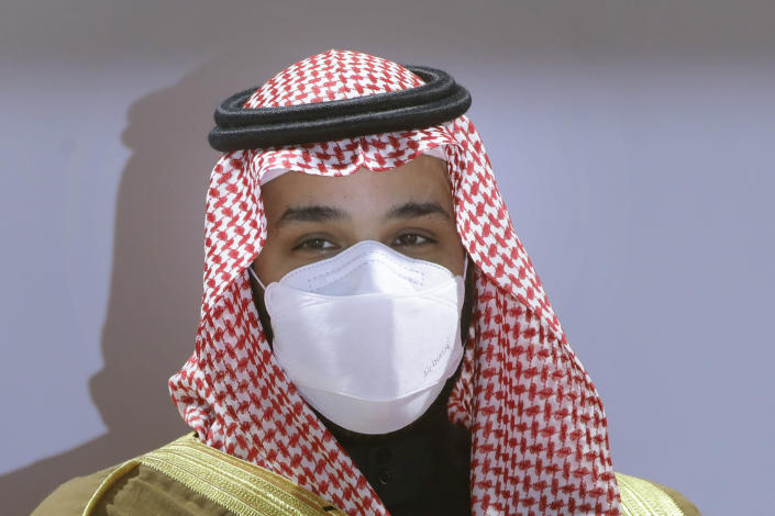 FILE - In this Feb. 20, 2021, file photo, Saudi Crown Prince Mohammed bin Salman wears a face mask to help curb the spread of the coronavirus as he attends the Saudi Cup award ceremony during the final race of the $20 million, the Saudi Cup, at King Abdul Aziz race track in Riyadh, Saudi Arabia. Top Biden administration officials on Tuesday, July 6, hosted a brother to Saudi Arabia's powerful crown prince, Mohammed bin Salman, in the highest-level such visit known since the U.S. made public intelligence findings linking the crown prince to the killing of journalist Jamal Khashoggi. (AP Photo/Amr Nabil, File)