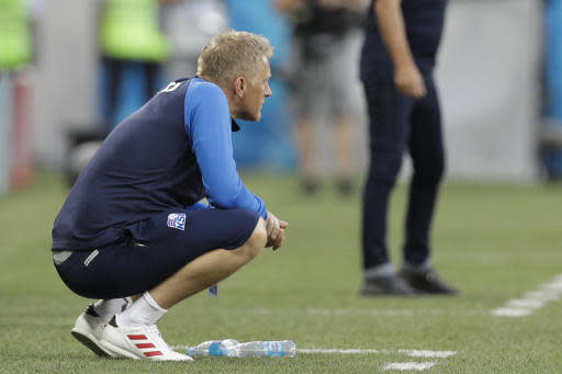 Iceland coach Heimar Hallgrimsson watches the group D match between Nigeria and Iceland at the 2018 soccer World Cup in the Volgograd Arena in Volgograd, Russia, Friday, June 22, 2018. (AP Photo/Andrew Medichini)