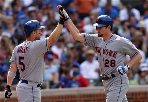 New York Mets' Daniel Murphy, right, is congratulated by teammate David Wright after hitting solo home run in the eighth inning of a baseball game against the Chicago Cubs in Chicago, Sunday, May 19, 2013. (AP Photo/Charles Cherney)