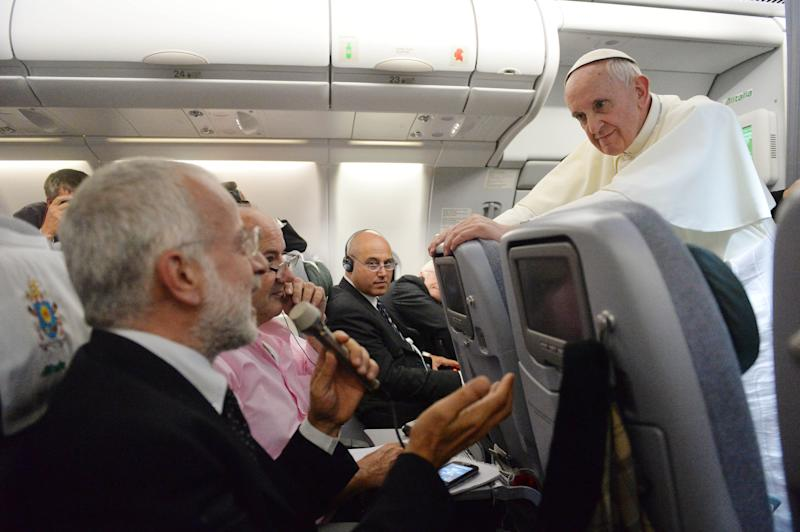 """Pope Francis answers reporters questions during a news conference aboard the papal flight on its way back from Brazil, Monday, July 29, 2013. Pope Francis reached out to gays on Monday, saying he wouldn't judge priests for their sexual orientation in a remarkably open and wide-ranging news conference as he returned from his first foreign trip. """"If someone is gay and he searches for the Lord and has good will, who am I to judge?"""" Francis asked. His predecessor, Pope Benedict XVI, signed a document in 2005 that said men with deep-rooted homosexual tendencies should not be priests. Francis was much more conciliatory, saying gay clergymen should be forgiven and their sins forgotten. Francis' remarks came Monday during a plane journey back to the Vatican from his first foreign trip in Brazil. (AP Photo/Luca Zennaro, Pool)"""