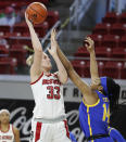 North Carolina State's Elissa Cunane (33) shoots as Pittsburgh's Cynthia Ezeja (14) defends during the first half of an NCAA college basketball game, Thursday, Feb. 25, 2021 in Raleigh, N.C. (Ethan Hyman/The News & Observer via AP, Pool)