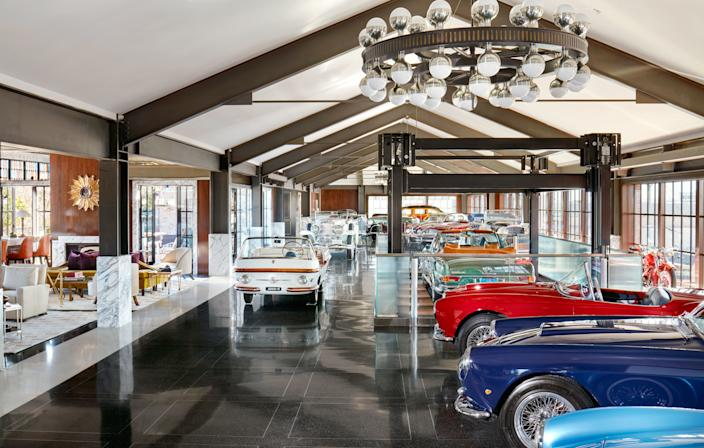 Another view of the main room. A 1956 Fiat Eden Roc stands at left.