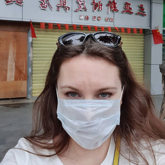 Alla Ilyina wearing a surgical mask in China. Source: Instagram