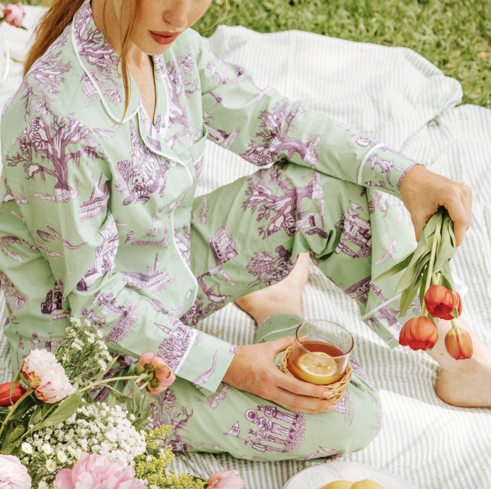 """<p><strong>Katie Kime</strong></p><p>katiekime.com</p><p><strong>$98.00</strong></p><p><a href=""""https://www.katiekime.com/products/new-orleans-pajama-set-green"""" rel=""""nofollow noopener"""" target=""""_blank"""" data-ylk=""""slk:Shop Now"""" class=""""link rapid-noclick-resp"""">Shop Now</a></p><p>Add one of four monogram styles to a pair of these city-themed toile pajamas. These PJs come in six cities, from Dallas and Austin, to Nashville and New Orleans. <br></p>"""