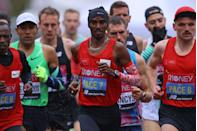 <p>Mo Farah running as a pacemaker during the race</p>