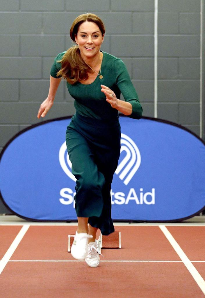 """<p>The Duchess is on the run! Kate wore an <a href=""""https://www.townandcountrymag.com/society/tradition/a31112240/kate-middleton-green-athleisure-look-sportsaid-photos/"""" rel=""""nofollow noopener"""" target=""""_blank"""" data-ylk=""""slk:all green athleisure look"""" class=""""link rapid-noclick-resp"""">all green athleisure look</a> to a SportsAid event at the London Stadium. She paired the outfit with Marks & Spencer <a href=""""https://www.townandcountrymag.com/society/tradition/a31115360/kate-middleton-marks-and-spencer-white-sneakers/"""" rel=""""nofollow noopener"""" target=""""_blank"""" data-ylk=""""slk:striped sneakers"""" class=""""link rapid-noclick-resp"""">striped sneakers</a>, and tried her hand at both racing on the track and taekwondo. </p>"""