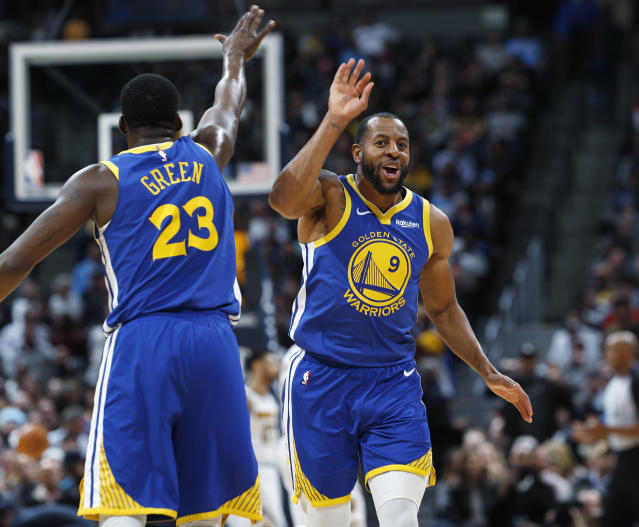 Golden State Warriors forward Draymond Green, left, congratulates guard Andre Iguodala after his dunk against the Denver Nuggets in the second half of an NBA basketball game, Tuesday, Jan. 15, 2019, in Denver. The Warriors won 142-111. (AP Photo/David Zalubowski)