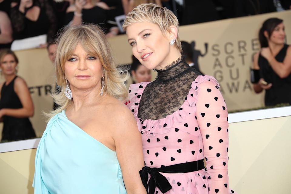 Mother and daughter Goldie Hawn, left, and Kate Hudson arrive for the Screen Actors Guild Awards in 2018 in Los Angeles.