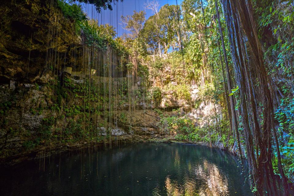 <em>Cenotes</em>—which are natural sinkholes or wells filled with water—were sacred to the Maya people, and used as communication portals with the gods. The Cenote Sagrado in Chichén Itzá, Mexico, is believed to have been the site of rituals, and offerings. Jewelry, incense, pottery, and copious remains of bodies—suggesting human sacrifices to the gods were made—have been discovered at the bottom by archaeologists. White this cenote was a pilgrimage destination for the Maya, today visitors can freely swim or take a dip in it.