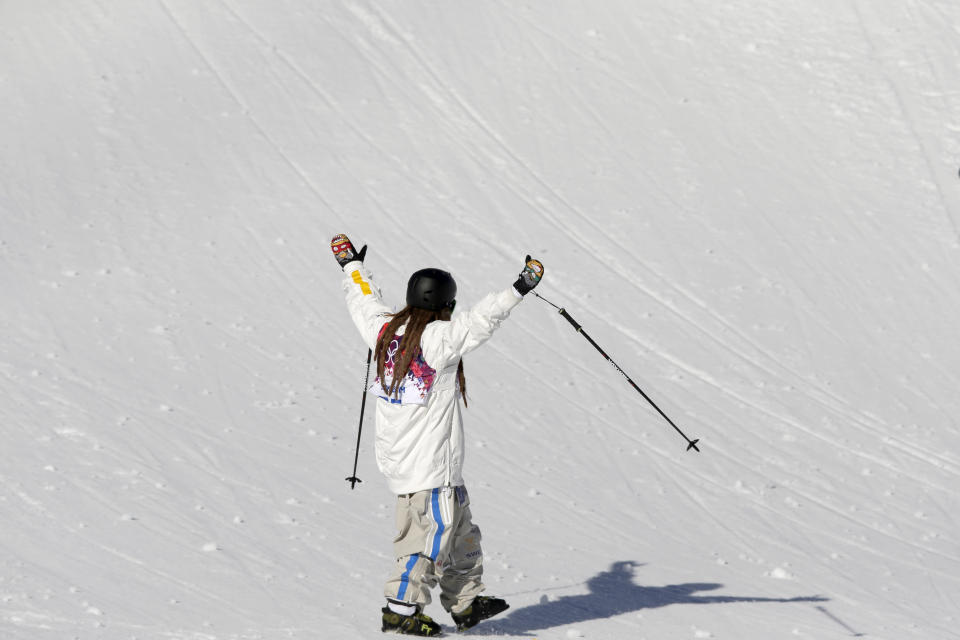 Sweden's Henrik Harlaut gestures to the crowd after crashing during the men's ski slopestyle qualifying at the Rosa Khutor Extreme Park, at the 2014 Winter Olympics, Thursday, Feb. 13, 2014, in Krasnaya Polyana, Russia. (AP Photo/Andy Wong)