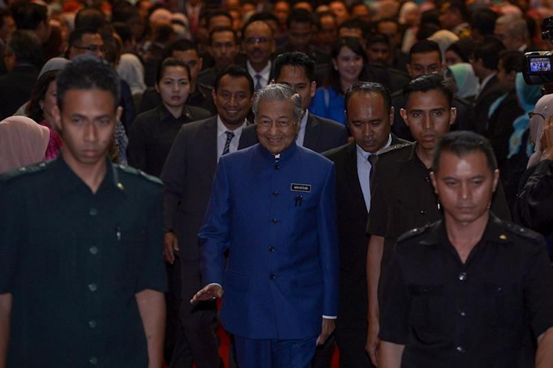 Prime Minister Tun Dr Mahathir Mohamad (centre) arrives for a Town Hall session with administrative and diplomatic officer at the Putrajaya International Convention Centre August 15, 2018. — Picture by Mukhriz Hazim