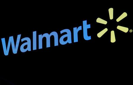 FILE PHOTO: The Walmart logo is displayed on a screen on the floor of the New York Stock Exchange (NYSE) in New York, U.S., May 1, 2018. REUTERS/Brendan McDermid/File Photo