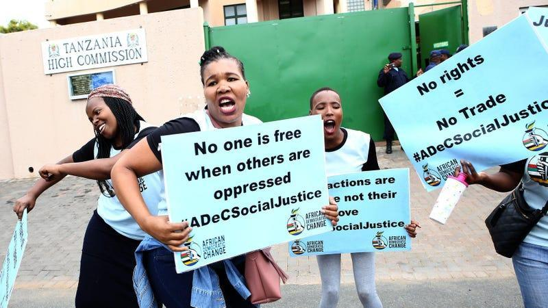 South African Members of the Lesbian, Gay, Bisexual, Transgender, Queer or Questioning and Intersex community (LGBTQI) protest outside the Tanzania High Commission on November 26, 2018 in Pretoria.