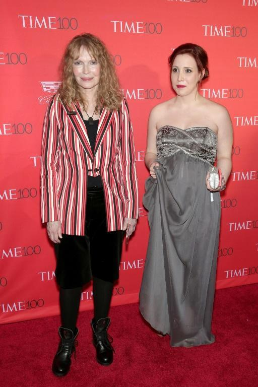 Mia Farrow (L) and Dylan Farrow at an appearance in New York in April 2016; Dylan Farrow has accused stepfather Woody Allen of sexually abusing her when she was only seven