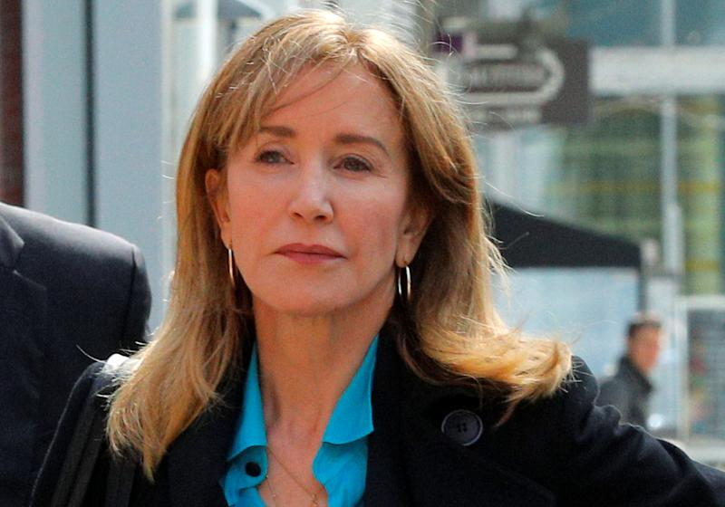 Actor Felicity Huffman, facing charges in a nationwide college admissions cheating scheme, enters federal court in Boston, Massachusetts, U.S., April 3, 2019. REUTERS/Brian Snyder