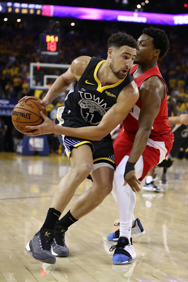 Klay Thompson #11 of the Golden State Warriors is defended by Kyle Lowry #7 of the Toronto Raptors in the first half during Game Four of the 2019 NBA Finals at ORACLE Arena on June 07, 2019 in Oakland, California. (Photo by Ezra Shaw/Getty Images)
