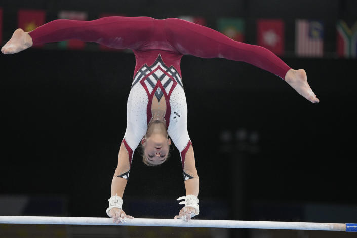 Pauline Schaefer-Betz, of Germany, performs on the uneven bars during the women's artistic gymnastic qualifications at the 2020 Summer Olympics, Sunday, July 25, 2021, in Tokyo. (AP Photo/Natacha Pisarenko)