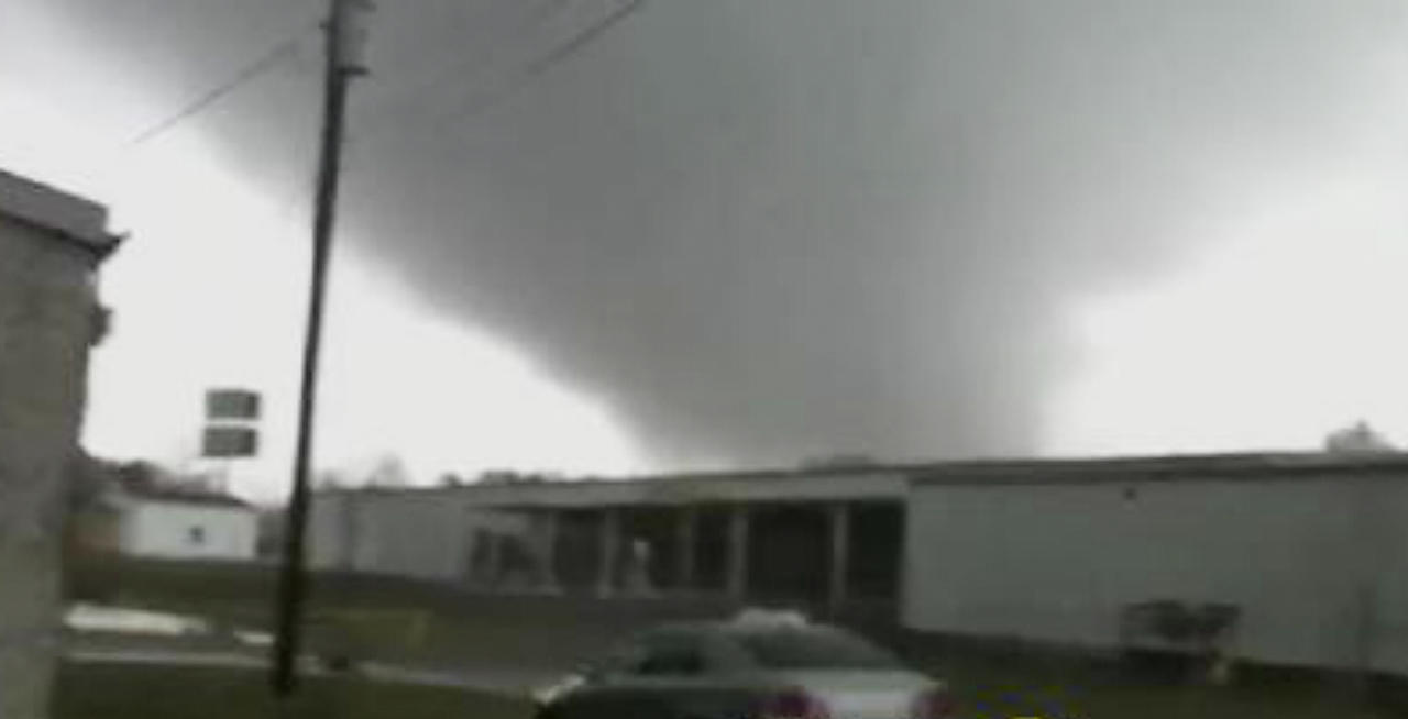 In this image made from video and released by WSB TV in Atlanta, a tornado moves through the town of Adairsville, Ga. on Wednesday, Jan 30, 2013. A fire chief says a storm that roared across northwest Georgia has left overturned vehicles on Interstate 75 northwest of Atlanta, and crews are responding to reports of people trapped in storm-damaged residential and commercial buildings. (AP Photo/WSB TV)