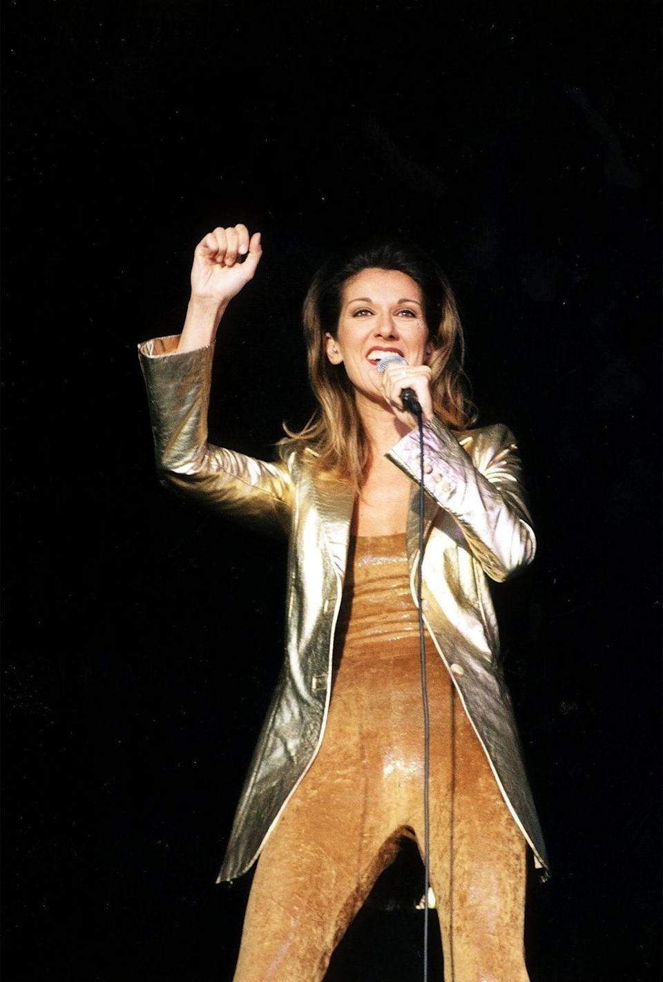 <p>The singer never seems to turn down an offer for a trendy jumpsuit. This camel-colored pick pairs well with her metallic blazer. </p>