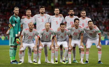 Spain players pose for a team group photo before the match. REUTERS/Ueslei Marcelino