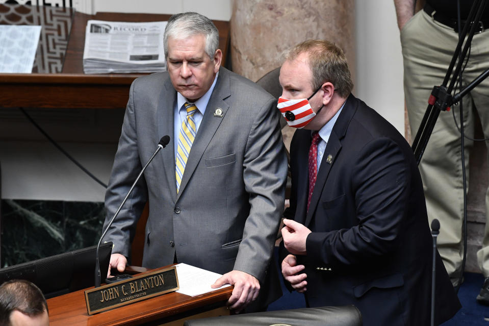 Kentucky State Representatives John Blanton, left, and Jason Nemes talk during a discussion on Ky. Senate Bill 4, an act relating to warrants authorizing entry without notice on the final day of the Legislature at the Kentucky State Capitol in Frankfort, Ky., Tuesday, March 30, 2021. (AP Photo/Timothy D. Easley)