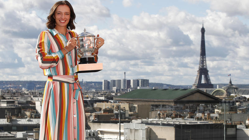 Iga Swiatek, pictured here with the trophy after winning the French Open.