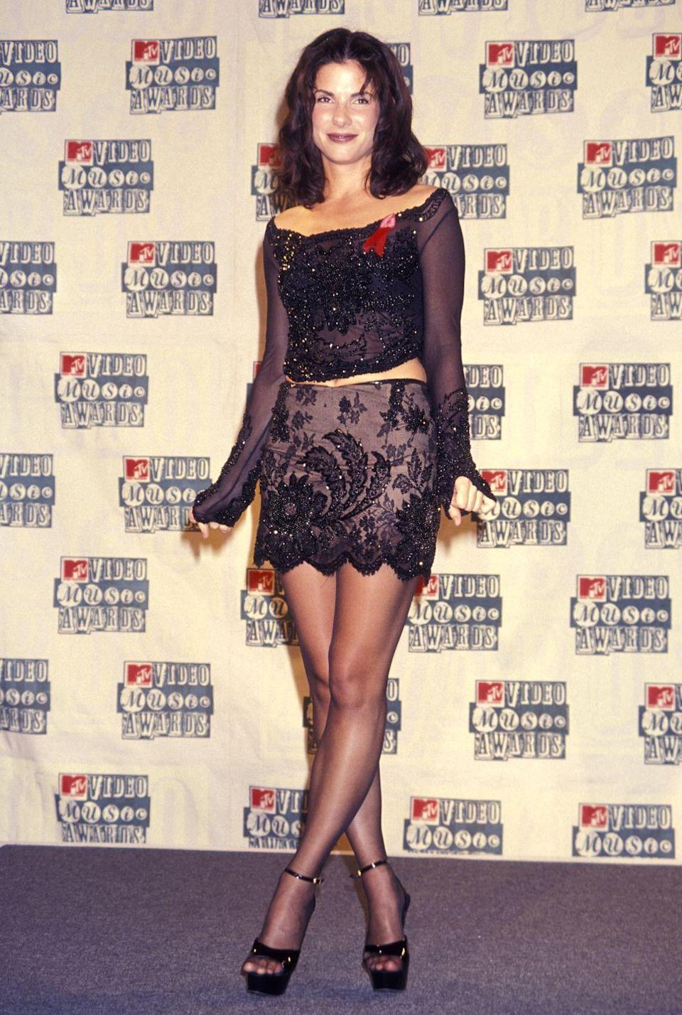 <p>Sandra Bullock wore this two-piece coordinating top and miniskirt look to the 1994 VMAs.</p>