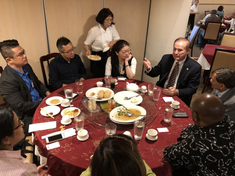 Journalists from the 2019 Jefferson Fellowships discussing immigration issues with Representative Gene Ward (pointing) of Hawaii, a Republican, on 26 April 2019. PHOTO: Nicholas Yong/Yahoo News Singapore