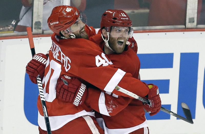 Detroit Red Wings right wing Daniel Cleary, right, celebrates his empty-net goal against the Chicago Blackhawks with teammate Henrik Zetterberg (40), of Sweden, during the third period in Game 4 of the Western Conference semifinals in the NHL hockey Stanley Cup playoffs in Detroit, Thursday, May 23, 2013. Detroit won 2-0. (AP Photo/Paul Sancya)