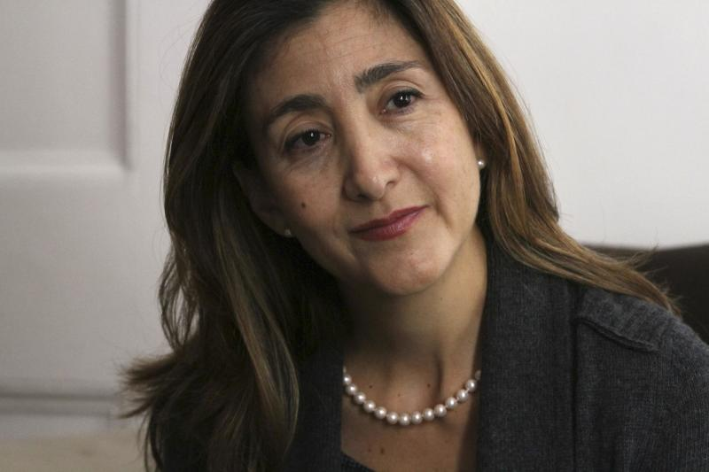 FILE - In this Sept. 21, 2010 file photo, former Colombian rebel hostage Ingrid Betancourt smiles during an interview in New York. A spokesman for Colombia's Green Party says Betancourt will seek to represent it in next year's presidential elections. Betancourt, a dual French-Colombian national, was kidnapped by the Revolutionary Armed Forces of Colombia, or FARC, in February 2002 while campaigning for president and was held captive for six years. (AP Photo/Tina Fineberg, File)