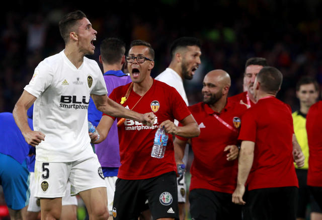 Valencia defender Gabriel Paulista, left, reacts as he celebrates his team's second goal during the Copa del Rey soccer match final between Valencia CF and FC Barcelona at the Benito Villamarin stadium in Seville, Spain, Saturday. 25, 2019. (AP Photo/Miguel Morenatti)