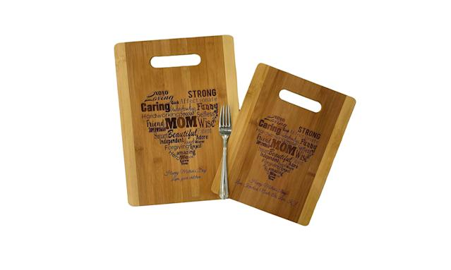 "<p>If your mom loves to cook, these custom cutting boards will make a great gift.<br><br>Custom Cutting Boards, $25, <a href=""https://www.amazon.com/dp/B01EK65FZY/ref=gbps_img_m-3_cd28_b1579156?smid=A2UO9MY2UXAFIZ&pf_rd_p=8d880419-7d85-4ca1-9cf9-4e6f9a1bcd28&pf_rd_s=merchandised-search-3&pf_rd_t=101&pf_rd_i=17608877011&pf_rd_m=ATVPDKIKX0DER&pf_rd_r=4E5DWZZACRVYTVN6BJ5M"" rel=""nofollow noopener"" target=""_blank"" data-ylk=""slk:amazon.com"" class=""link rapid-noclick-resp"">amazon.com</a> </p>"