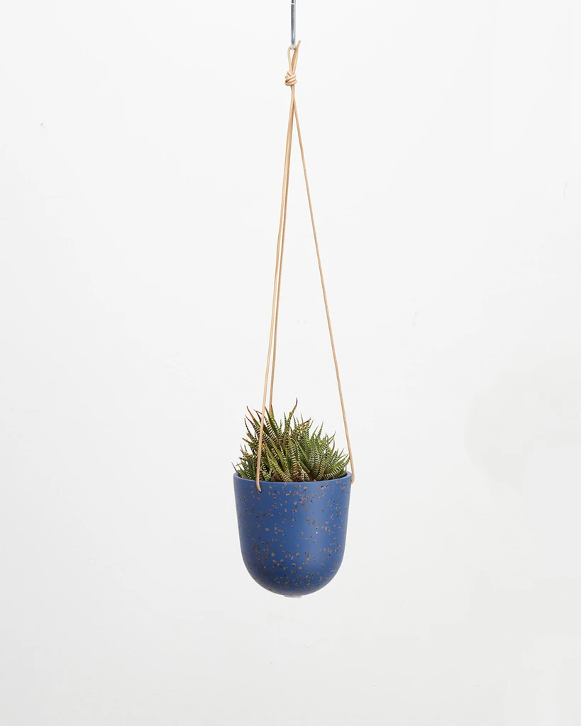 """<h2>Capra Designs Terrazzo Hanging Pot</h2><br>This pretty planter is artfully crafted from a rich blue, terrazzo-speckled resin that's suspended by a tan-leather strap. <br><br><strong>Capra Designs</strong> Terrazzo Hanging Planter, $, available at <a href=""""https://go.skimresources.com/?id=30283X879131&url=https%3A%2F%2Fwww.bando.com%2Fproducts%2Fterrazzo-hanging-planter-neptune-terrazzo"""" rel=""""nofollow noopener"""" target=""""_blank"""" data-ylk=""""slk:Bando"""" class=""""link rapid-noclick-resp"""">Bando</a>"""
