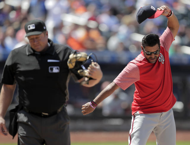 Washington Nationals manager Dave Martinez, right, reacts after being ejected by home plate umpire Bruce Dreckman for arguing after Nationals' Howie Kendrick was called out on strikes during the eighth inning of a baseball game against the New York Mets, Thursday, May 23, 2019, in New York. (AP Photo/Julio Cortez)