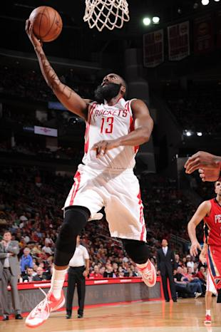 HOUSTON, TX - APRIL 12: James Harden #13 of the Houston Rockets goes to the basket against the New Orleans Pelicans on April 12, 2015 at the Toyota Center in Houston, Texas. (Photo by Bill Baptist/NBAE via Getty Images)